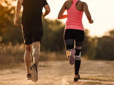 Une séance de running en extérieur avec un coach sportif